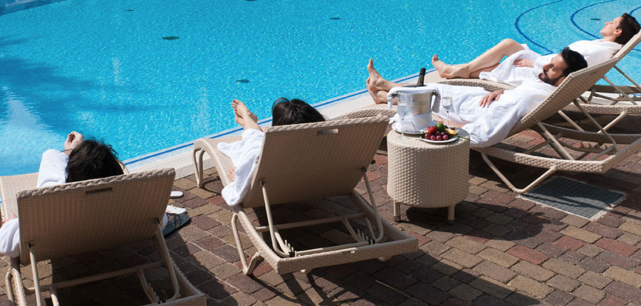 Hotel Villa Nicolli, Riva, Lake Garda, Italy - guests relaxing by outdoor pool.jpg